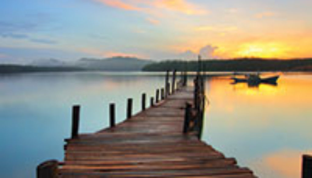 Wooden dock during sunset.