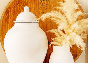 White Urn and vase with feathers.