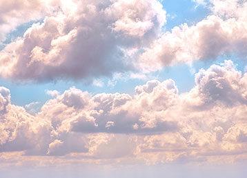 Puffy clouds in the sky.
